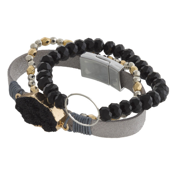 """Multi strand natural stone and  beaded bracelet with metal hoop wrist detail. Approximate 6"""" in length."""