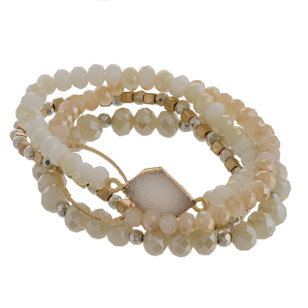 "Multi strand stretch beaded bracelet with natural stone.  Approximate 6"" in length."