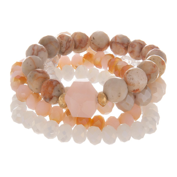 "Set of 4 natural stone beaded stretch bracelets with gold accents. Approximately 2.5"" in diameter unstretched. Fits up to a 6"" wrist."