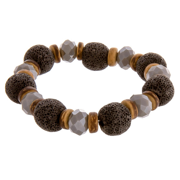 """Beaded stretch bracelet featuring natural stones, lava rock, and wood beads. Approximately 2.75"""" in diameter unstretched. Fits up to 5"""" wrist."""