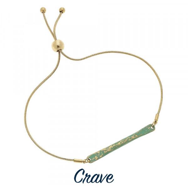 Dainty adjustable gold tone bracelet with hammered metal patina bar focal.
