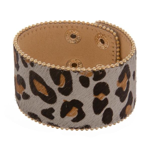 """Leather animal print bracelet with two adjustable snap buttons. Approximate 8"""" in length."""