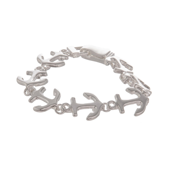 "Metal bracelet with anchor details. Approximate d7"" in length."