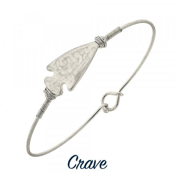 "Metal bracelet with arrow wrist details. Approximate 2"" in diameter."