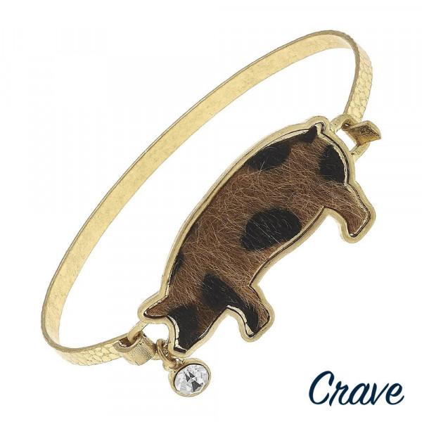 "Metal bracelet with pig details. Approximate 2.5"" in diameter."