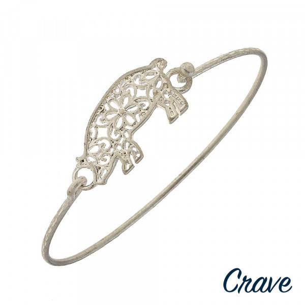 "Metal bracelet with  filigree pig details. Approximate 2.5"" in diameter."