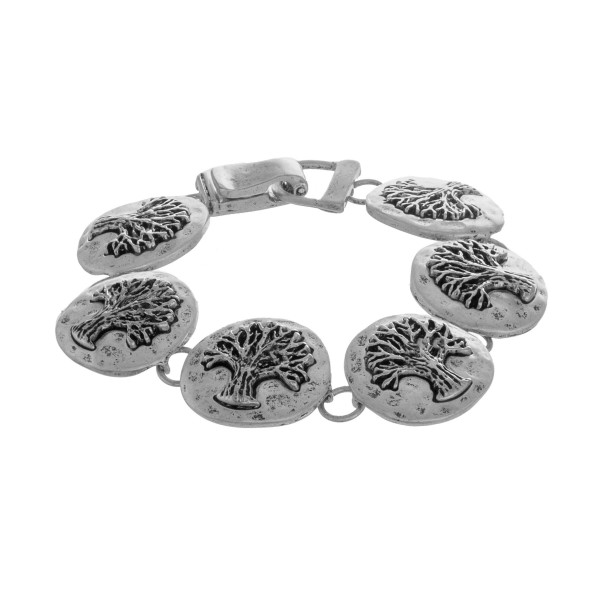 "Metal bracelet with 'tree of life detail. Approximate 8"" in length."