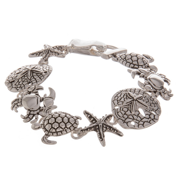 "Metal bracelet with turtle details. Approximate 7"" in length."