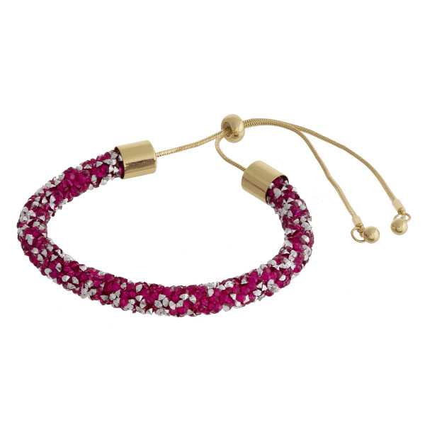 """Fuchsia and silver rhinestone bracelet featuring a adjustable bolo closure. Approximately 3"""". Fits up to a 6"""" wrist."""