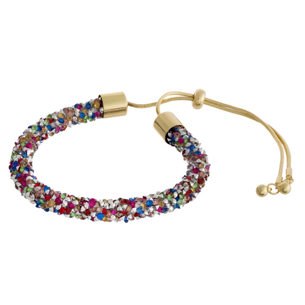 """Multi, gold and silver rhinestone bracelet featuring a adjustable bolo closure. Approximately 3"""". Fits up to a 6"""" wrist."""