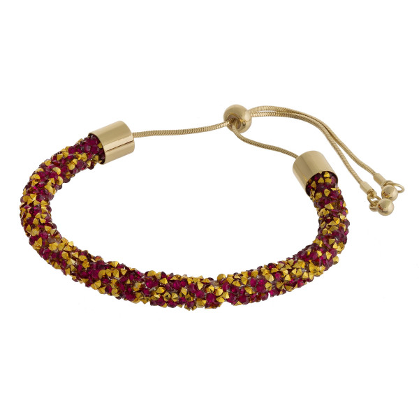 """Red and gold rhinestone bracelet featuring a adjustable bolo closure. Approximately 3"""". Fits up to a 6"""" wrist."""