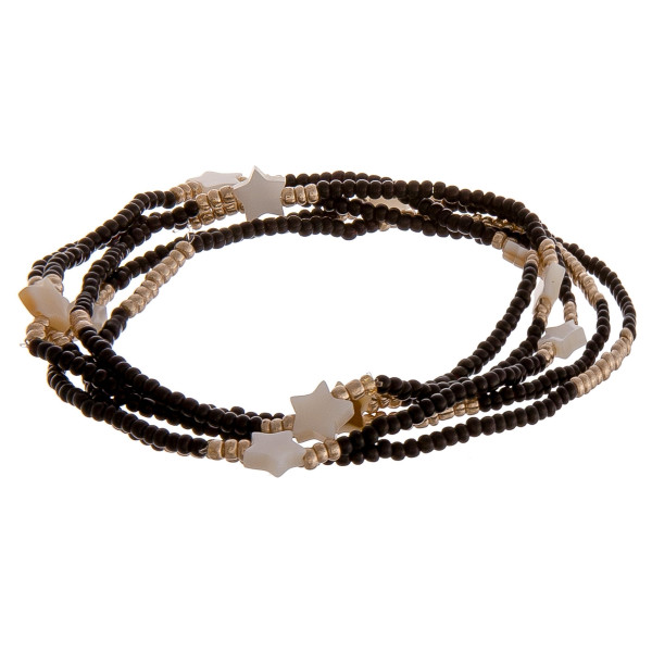 "Set of five stretch bracelet featuring black and gold beads with star details. Approximately 2.5"" in diameter unstretched. Fits up to 5"" wrist."