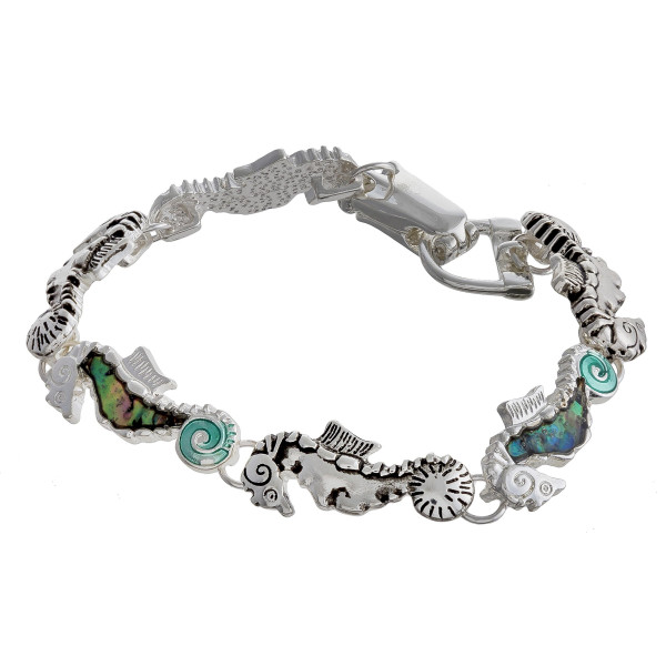 """Metal bracelet with seahorse details. Approximate 7"""" in length."""