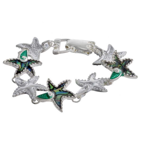 "Metal bracelet with starfish details. Approximate 7"" in length."