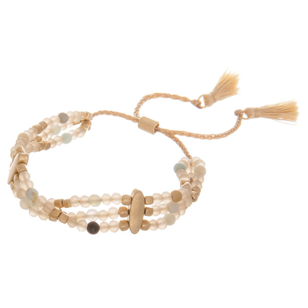 """Multi strand natural stone beaded bracelet with adjustable strap. Approximate 6"""" in length."""