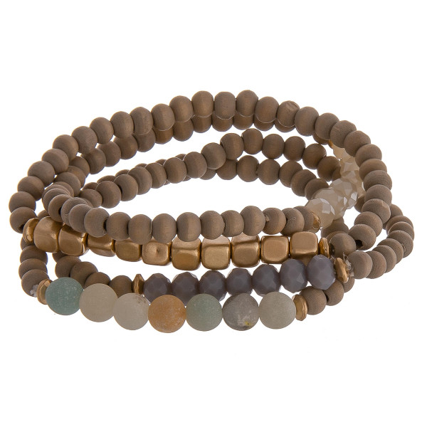 """Set of 4 natural stone inspired beaded bracelets featuring gold details and lavender accents. Approximately 2.5"""" in diameter unstretched. Fits up to a 6"""" wrist."""