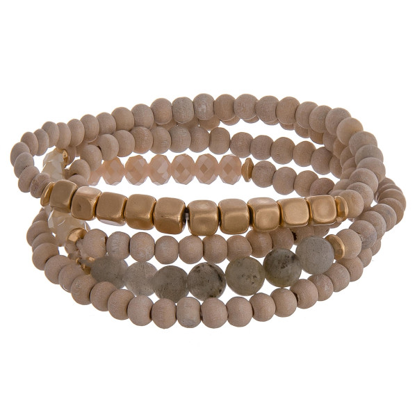 """Set of 4 natural stone inspired beaded bracelets featuring gold details and grey accents. Approximately 2.5"""" in diameter unstretched. Fits up to a 6"""" wrist."""