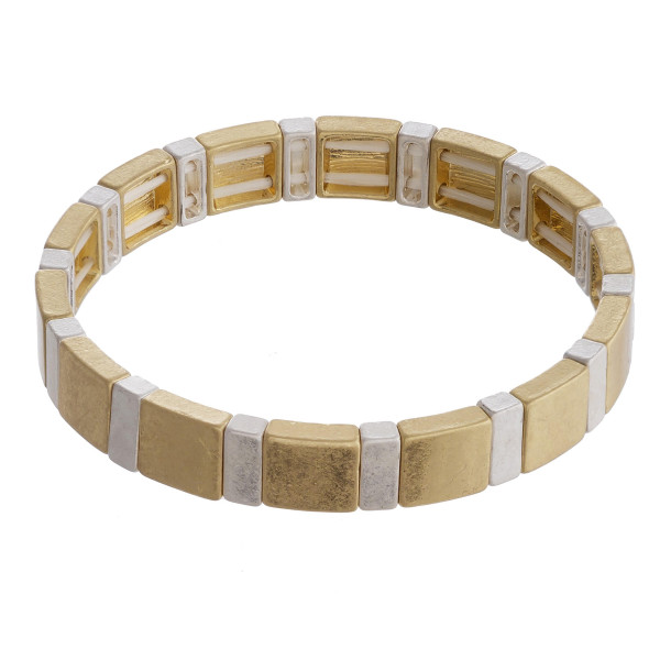 """Two tone gold and silver color block stretch bracelet. Approximately 3"""" in diameter unstretched. Fits up to a 6"""" wrist."""