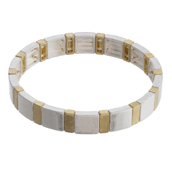 """Two tone silver and gold color block stretch bracelet. Approximately 3"""" in diameter unstretched. Fits up to a 6"""" wrist."""