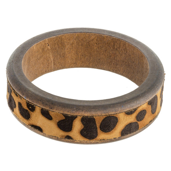 """Wood bracelet featuring snake skin faux leather. Approximately 3"""" in diameter. Fits up to a 6"""" wrist."""