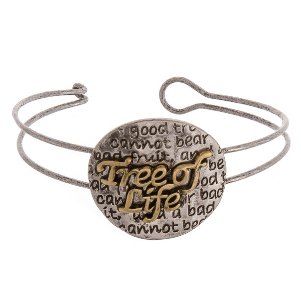 "Metal bangle bracelet featuring a circular pendant with a ""tree of life"" inspiring message and hook closure. Approximately 2"" in diameter unstretched. Fits up to 4"" wrist."