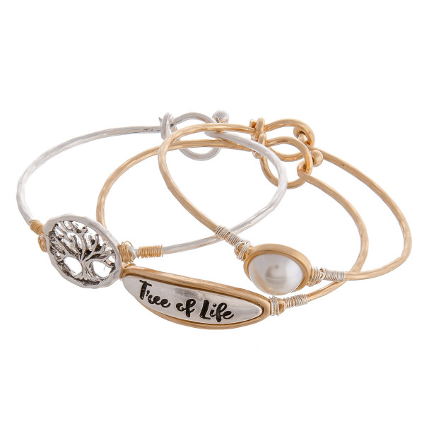 "Trio bangle bracelet set featuring a pearl, tree of life symbol and ""Tree of Life"" engraved focal with wire wrapped details. Approximately 3"" in diameter. Fits up to a 6"" wrist."