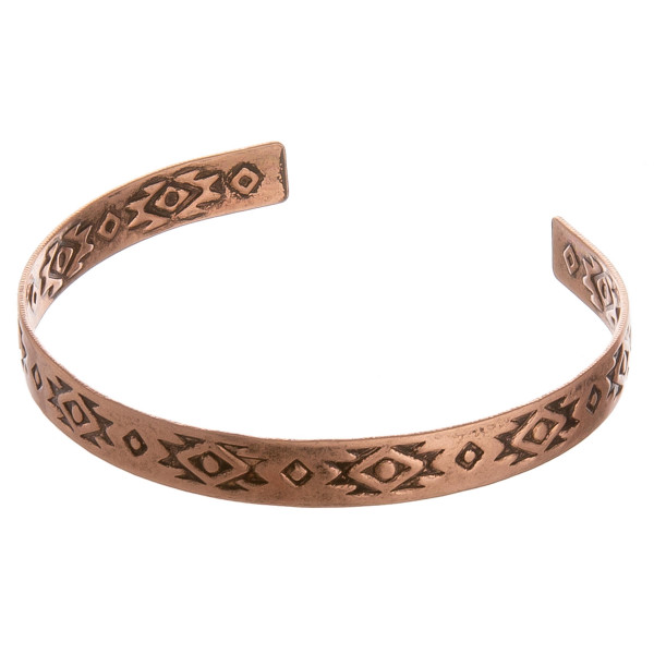 """Metal cuff bracelet featuring a tribal inspired pattern. Approximately 2.5"""" in diameter. Fits up to a 5"""" wrist."""