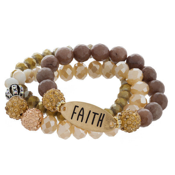 """Multi strand natural beaded bracelet with """"Faith"""" engraved message. Approximate 6"""" in length."""