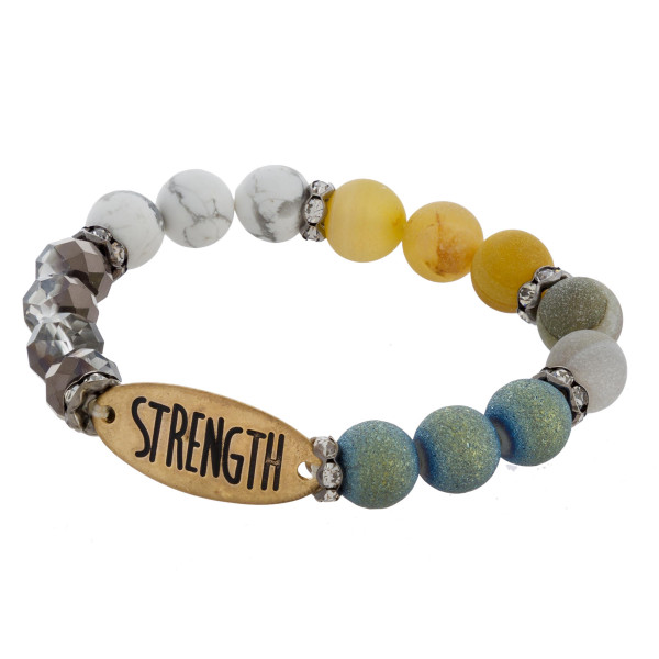 """Natural beaded stretch bracelet with """"Strength"""" message. Approximate 6"""" in length."""