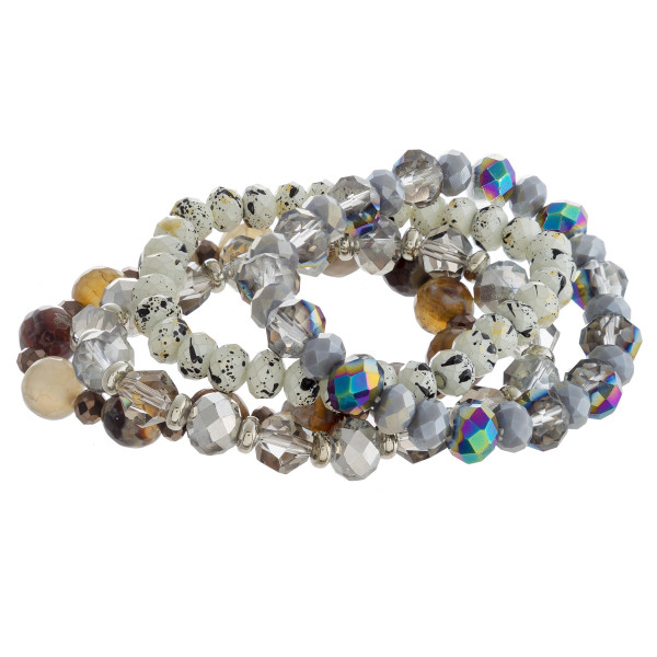 "Bracelet set featuring four stretch bracelets with faceted and iridescent beaded details. Approximately 3"" in diameter unstretched. Fits up to a 6"" wrist."