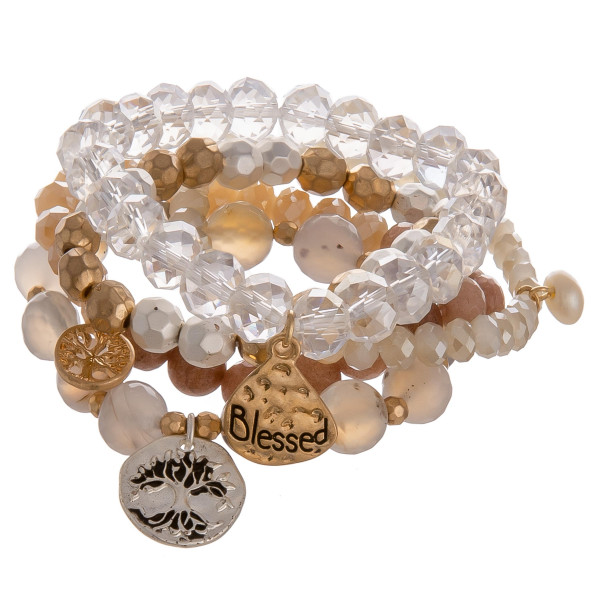 "Bracelet set featuring five beaded stretch bracelets with a ""Blessed"" inspiring message charm, a ""Tree of Life"" charm and a pearl accent. with Approximately 2.75"" in diameter unstretched. Fits up to a 5.5"" wrist."