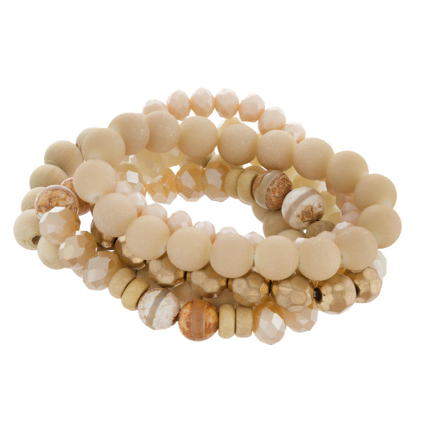 """Natural stone, wood and bead stretch bracelet. Approximate 6"""" in length."""