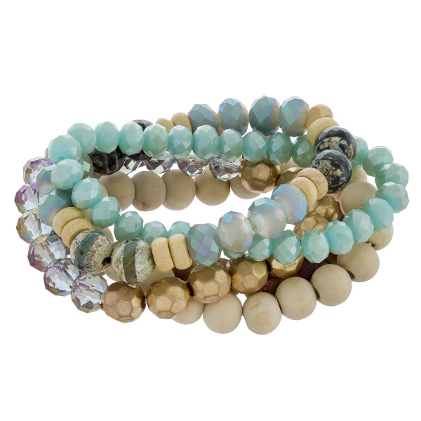 "Bracelet set featuring five beaded stretch bracelets with wood, natural stone, and iridescent bead details. Approximately 3"" in diameter unstretched. Fits up to a 6"" wrist."