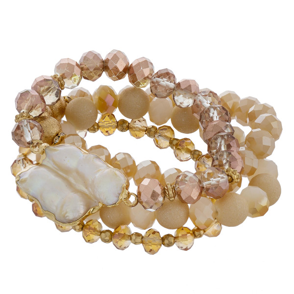 "Stretch bracelet with natural stone and bead detail  pearl wrist detail. Approximate 6"" in length."