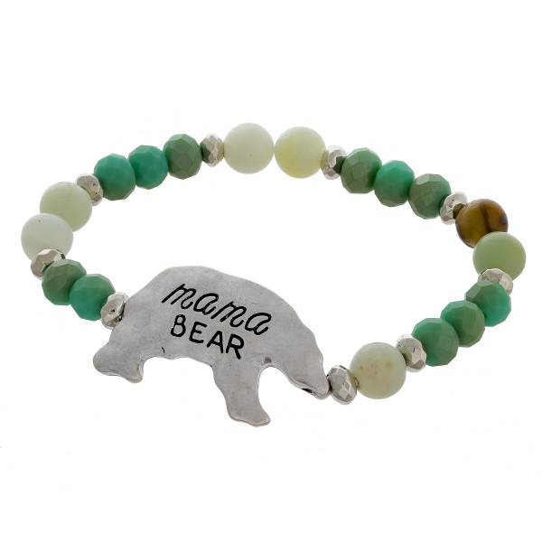 "Beaded stretch bracelet featuring ""Mama Bear"" engraved focal and natural stone inspired beads. Approximately 3"" in diameter unstretched. Fits up to a 6"" wrist."