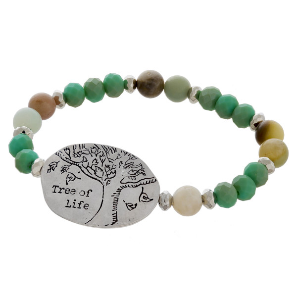 """Stretch beaded bracelet with tree of life  engraved detail. Approximate 6"""" in length."""