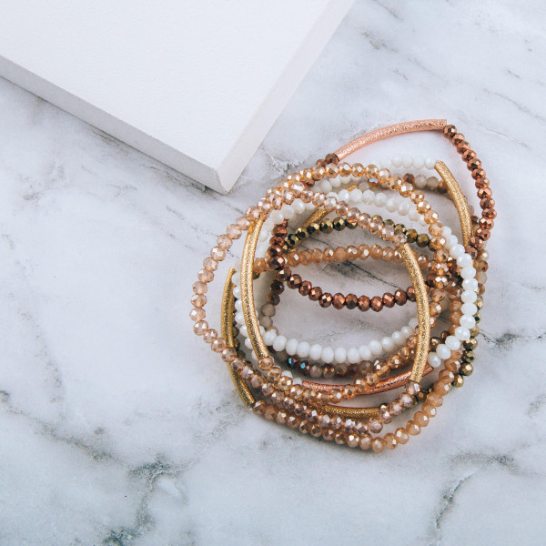 """Iridescent beaded stretch bracelet featuring a rose gold focal accent. Approximately 3"""" in diameter unstretched. Fits up to a 6"""" wrist."""