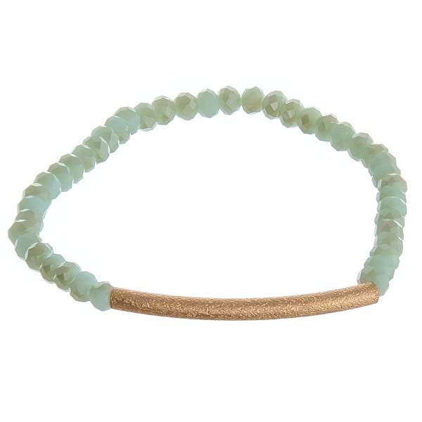 "Beaded stretch bracelet featuring mint beads and a gold accent. Approximately 2"" in diameter unstretched. Fits up to 5"" wrist."