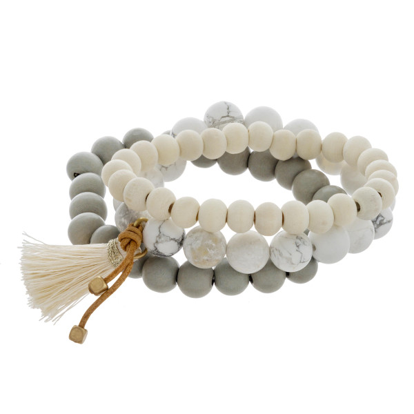 "Bracelet set featuring wood and natural stone beaded details with a tassel accent. Approximately 3"" in diameter unstretched. Fits up to a 6"" wrist."