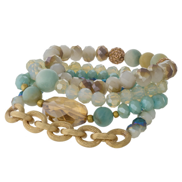 """Bracelet set featuring four beaded stretch bracelets with iridescent and natural stone bead details with a gold chain and crystal inspired accent. Approximately 3"""" in diameter unstretched. Fits up to a 6"""" wrist."""