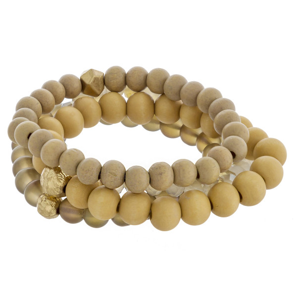 """Set of four beaded stretch bracelets featuring wooden, faceted bead details, and gold metal accents. Approximately 3"""" in diameter unstretched. Fits up to 6"""" wrist."""
