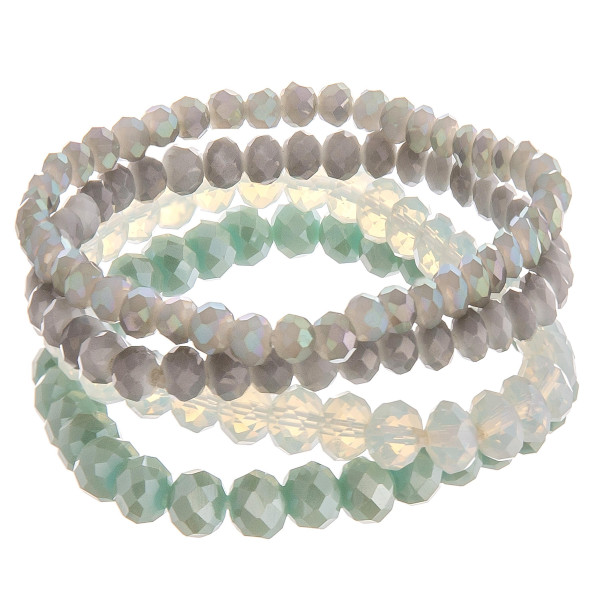 "Bracelet set featuring four iridescent beaded stretch bracelets. Approximately 3"" in diameter unstretched. Fits up to a 6"" wrist."