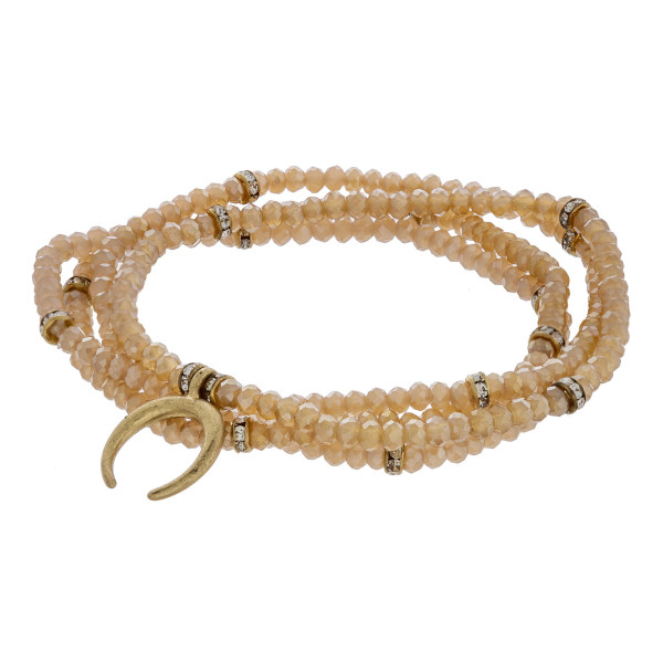 """Bracelet set featuring four iridescent beaded stretch strands with a crescent charm and gold accents. Approximately 3"""" in diameter unstretched. Fits up to a 6"""" wrist."""