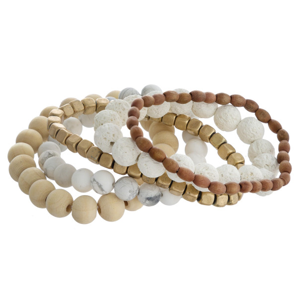 "Bracelet set featuring five stretch bracelets with wood, natural stone and lava rock inspired beads and gold accents. Approximately 2.5"" in diameter unstretched. Fits up to a 5"" wrist."