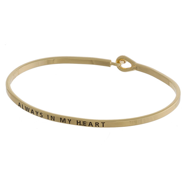 """Metal bracelet with engraved message always in my heart. Approximate 2"""" in diameter."""