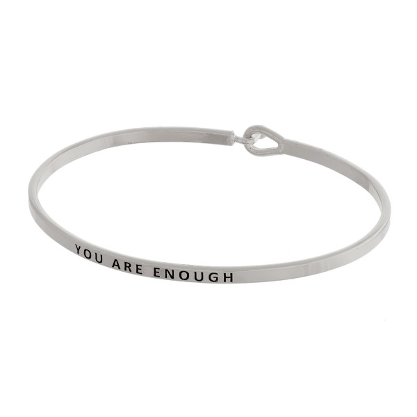 "Dainty metal bracelet featuring ""You Are Enough"" engraved message with a hook closure. Approximately 2.5"" in diameter. Fits up to a 5"" wrist."