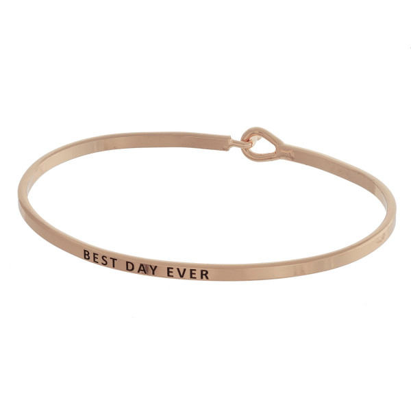 "Dainty metal bracelet featuring ""Best Day Ever"" engraved message with a hook closure. Approximately 2.5"" in diameter. Fits up to a 5"" wrist."