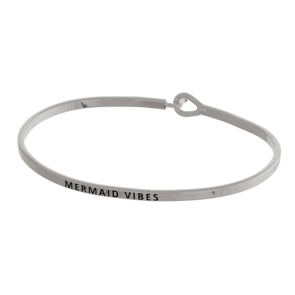 "Metal bracelet with engraved message, ""Mermaid Vibes."" Approximate 2"" in diameter."