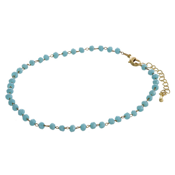 """Beaded anklet featuring faceted bead details. Approximately 4"""" in diameter. Fits up to a 8"""" ankle."""