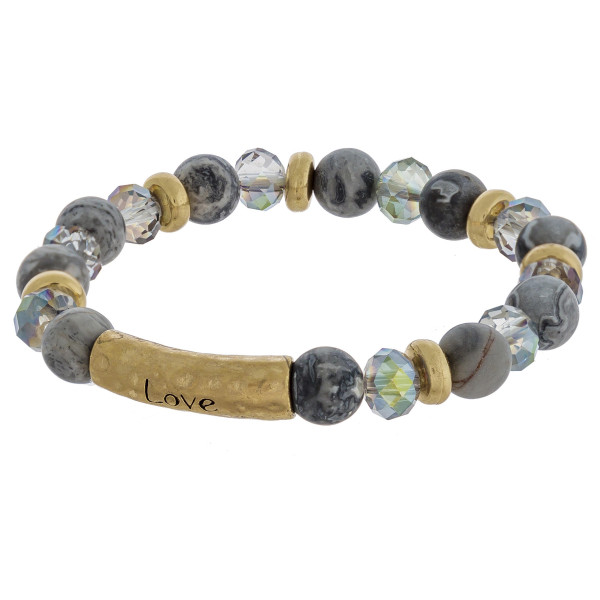 """Beaded stretch bracelets featuring a metal accent engraved with the word """"Love"""". Approximately 2.5"""" in diameter unstretched. Fits up to a 6"""" wrist."""